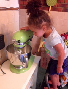 Olivia helping bake